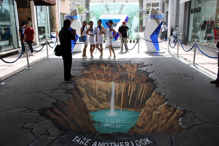 Posing by 3D Street Painting