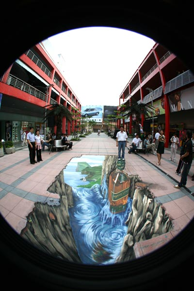 People being photographed in 3D optic illusion in Taipei