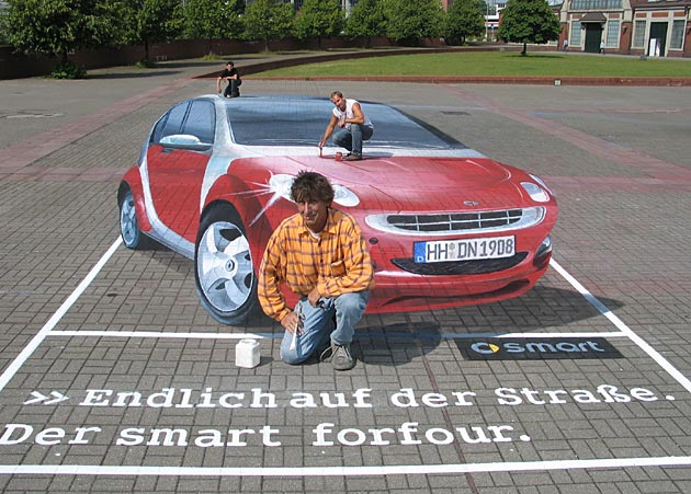 Artist with his 3D street painting - perspective playing tricks with perspective