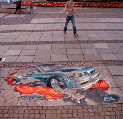 3D illusion of Need for Speed car crashing out of pavement in Leipzig Games convention