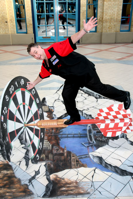 John Part posing with 3d optic illusion street painting at world darts championship
