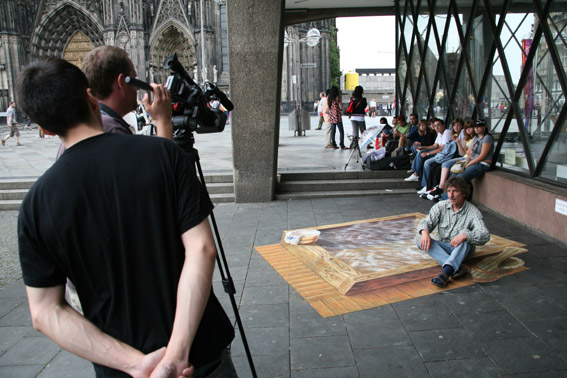 TV crew documenting the making of 3D street painting for Fuji TV's Unbelievable