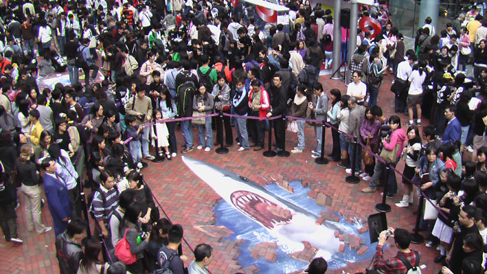 Line of people waiting to interact with 3D street art in Hong Kong