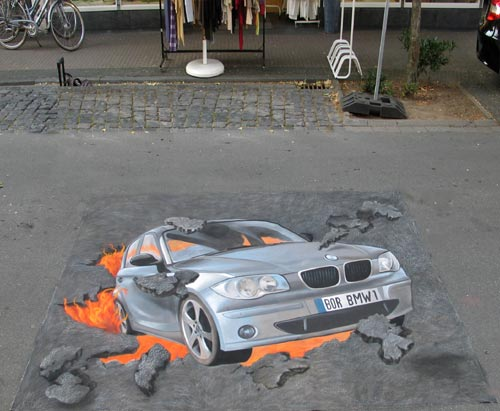 Optical illusion of BMW crashing through pavement