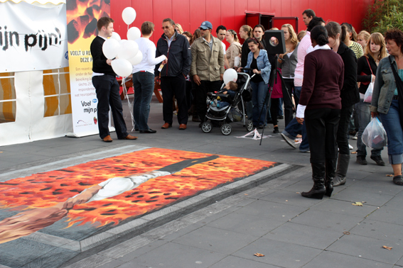 People looking at street art for Pfizer