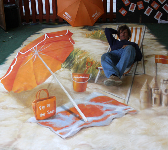 Lounging and dreaming in a street painting optical illusion in Edinburgh made for Easyjet