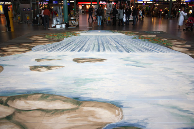 Upside down view of trompe l'oeil at Schiphol airport for Kneipp