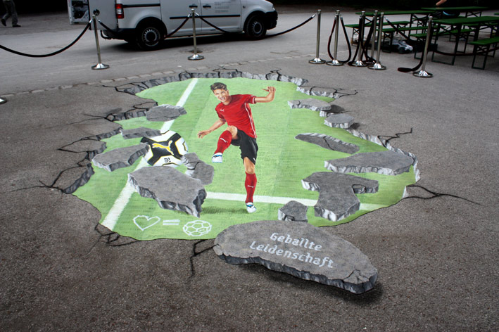 Finished anamorphic pavement drawing for Mario Gomez by Puma