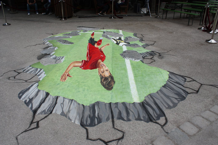 Upside down view of 3D street painting for Mario Gomez from Puma