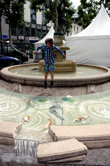 Boy enjoying 3D pavement art in Limburg