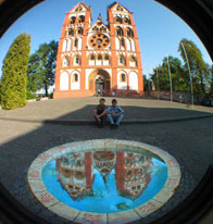 Optic illusion of a church reflectioni in a puddle