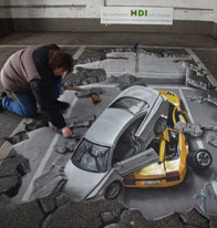 Optic illusion of a car fallen through the floor
