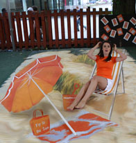 Miss Scotland posing with a 3D illusion of a beach