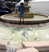 Illusion of a spilling fountain with fish